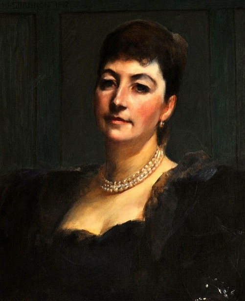 Lady Wearing A Black Dress And A Pearl Necklace