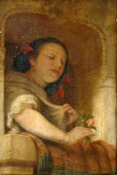 Young Woman At A Balcony With Flowers In Hand