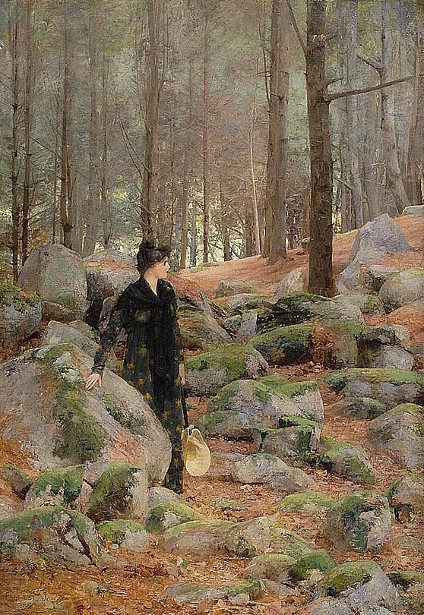A Woman Standing In A Forest Interior