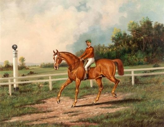 Chestnut Racehorse With Jockey Up On A Training Track With A Wooded Landscape Beyond