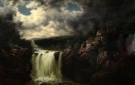 Cascading Falls Under Stormy Skies