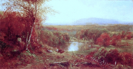 Cows At Rest By A Lake In An Autumn Landscape