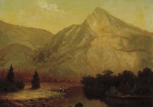 Riverbank In Front Of A Mountain